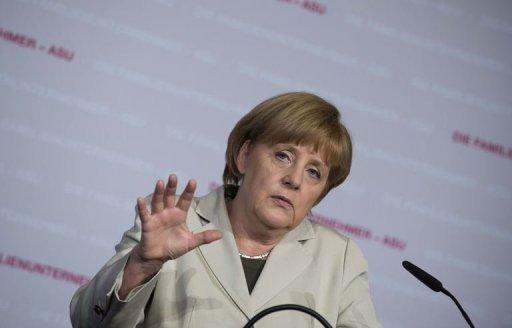 <p>German Chancellor Angela Merkel addresses guests at the Family Business Day in Berlin, Germany on April 26, 2013. An unusually virulent attack on Merkel by Francois Hollande's party has raised the pressure on France's president to stand up to his German counterpart and reignited the austerity debate in the crisis-hit eurozone.</p>