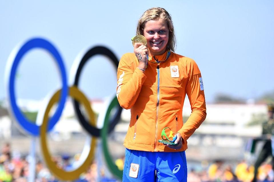 Sharon Van Rouwendaal at the women's 10k swim medal ceremony in Copacabana on August 15, 2016 (AFP Photo/Leon Neal)