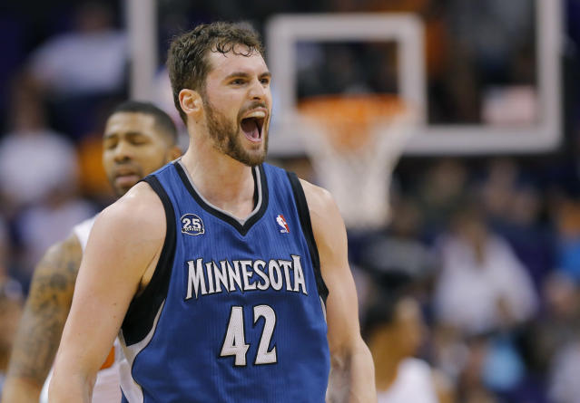 Minnesota Timberwolves forward Kevin Love (42) yells after hitting a three pointer against the Phoenix Suns during the second half of an NBA basketball game, Tuesday, Feb. 25, 2014, in Phoenix. (AP Photo/Matt York)