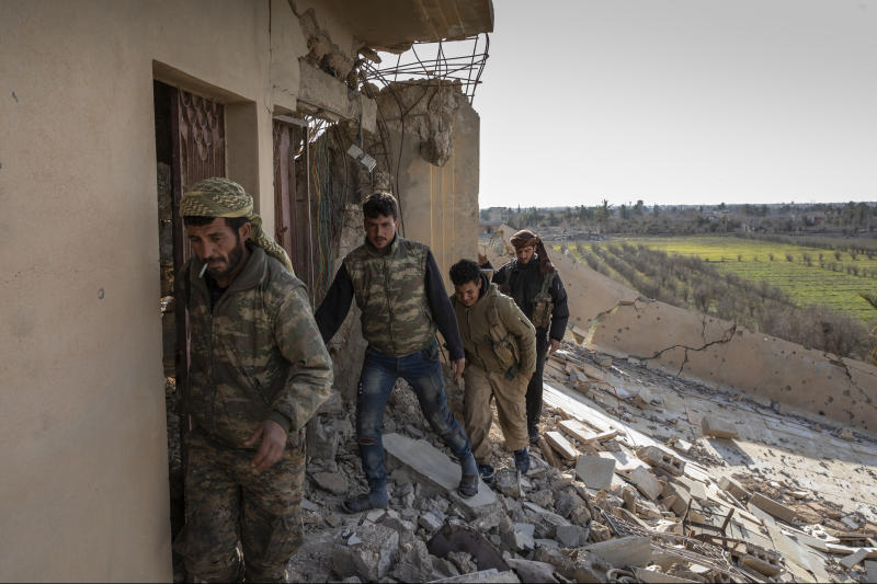Fighters with the Syrian Democratic Forces near Baghuz, then the last Islamic State stronghold, in Syria, Feb. 2, 2019. (Ivor Prickett/The New York Times)