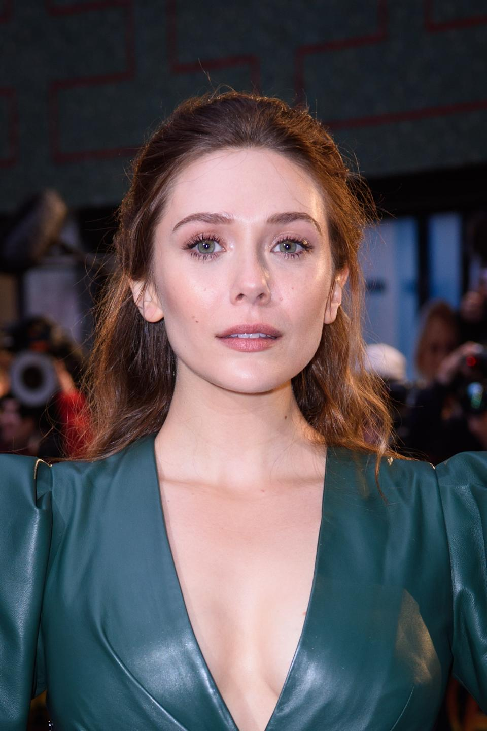 Elizabeth Olsen said the paparazzi were obsessed with her elder sisters turning 18PA