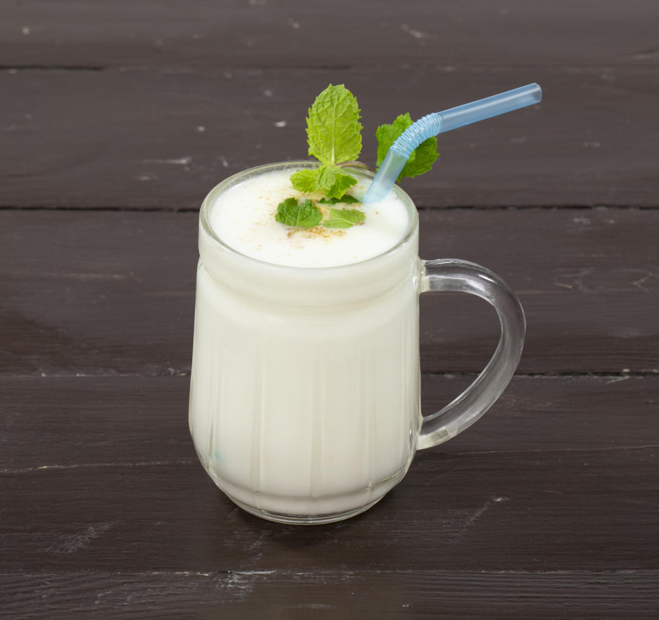 Fresh Summer Buttermilk drink. Made of yogurt or chaas on wooden background