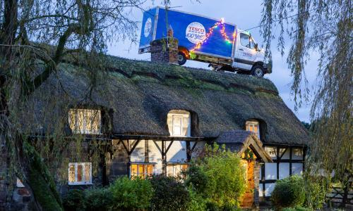 Noel parking: Tesco van parks on a roof to start Christmas ad blitz