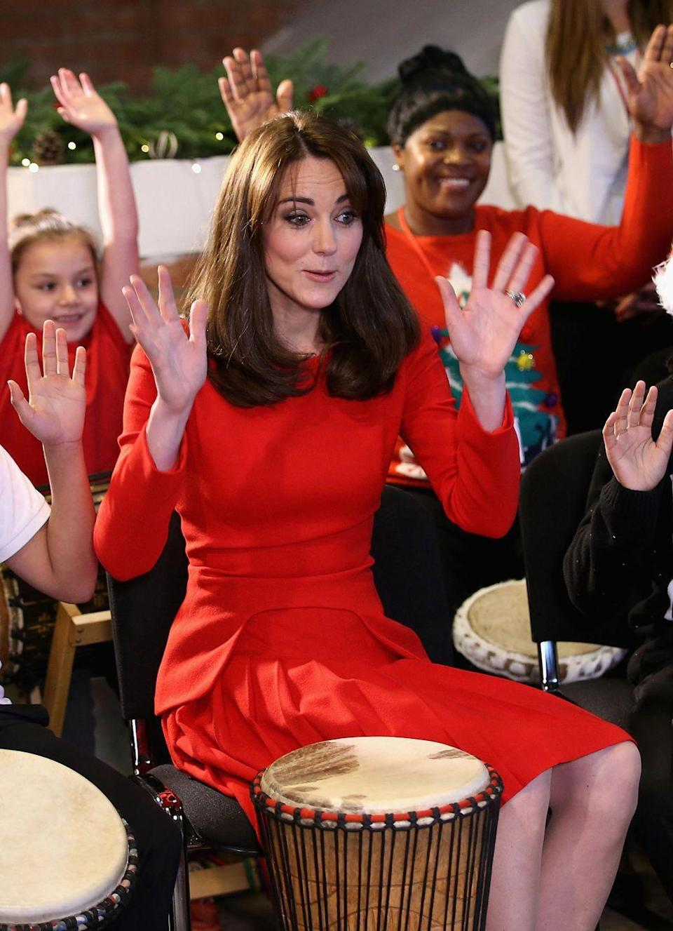 <p>For this dress's threepeat, Kate sported her infamous fringe. The bright red suited the occasion: a Christmas party at the Anna Freud Centre Family School. And she did a hand dance with the kids!</p>