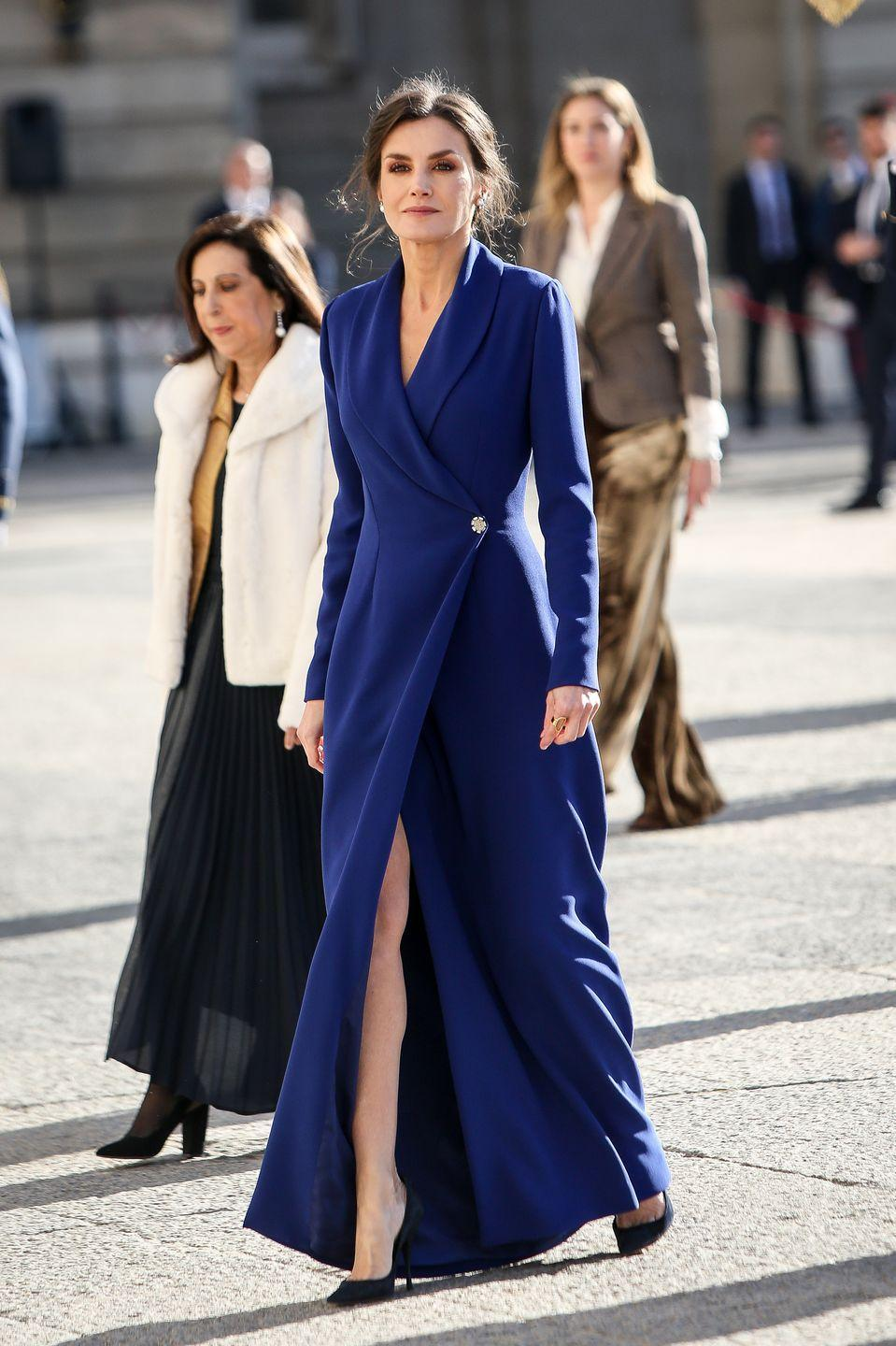<p>At the New Year Military Parade in Madrid, Letizia stunned in a navy blue wrap dress with a high slit. </p>