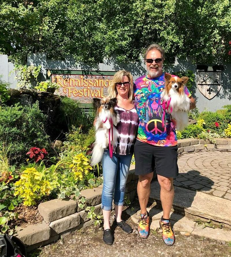 Kim Thompson and Art Molett at the Renaissance Festival in Michigan in August 2019.The couple poses with Thompson's Papillon dogs: Cari in her arms and Annika in Molett's.