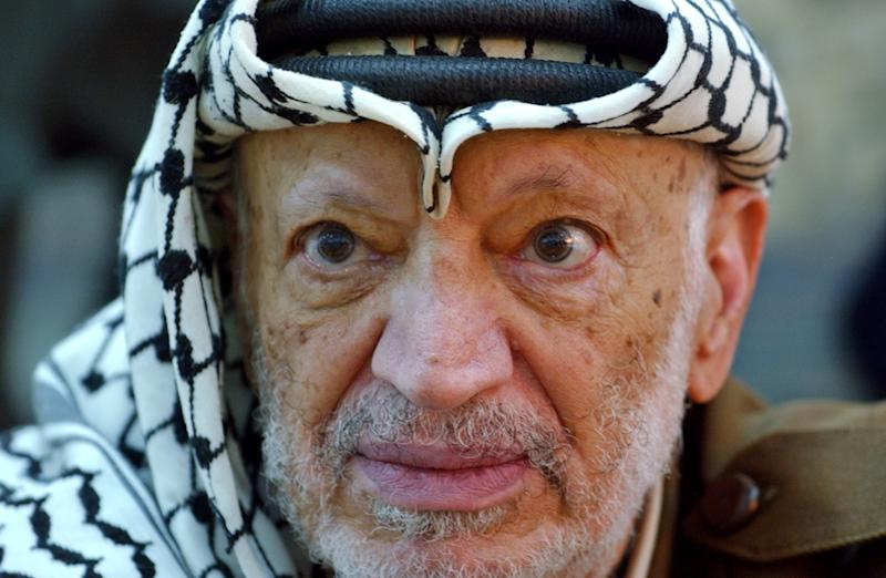 FILE - In this Saturday, Oct. 2, 2004 file photo, Palestinian leader Yasser Arafat pauses during an emergency cabinet session, at his compound, in the West Bank town of Ramallah. The widow of Yasser Arafat on Tuesday July 31, 2012 formally asked for a French investigation into his death, bringing a complaint of assassination weeks after raising new suspicions that the former Palestinian leader was poisoned before his 2004 death in a French military hospital. Earlier this month, Palestinian authorities gave final approval for Arafat's body to be exhumed. (AP Photo/Muhammed Muheisen, File)