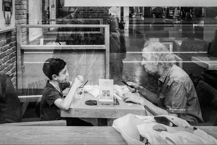 "<p><span style=""color: #000000; font-family: arial, sans, sans-serif; font-size: 13px; white-space: pre-wrap; background-color: #ffffff;"">I was passing by this restaurant and looked inside and saw this boy with his grandfather sharing a meal. ...My grandfather took care of me when I was a kid and growing up I was always told that I looked exactly like him. In many ways me capturing my reflection alongside this boy and his grandfather was me reflecting on the relationship I shared with mine. To me an unlikely hero is someone who makes a positive impact in your life, believes in you and helps you through your struggles. Photo by <a href=""https://www.eyeem.com/p/68678263"" target=""_blank"">Ron Anthony Bautista/Eyeem.</a></span></p>"