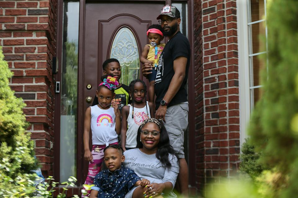 The Muntaqim family in Macomb, Michigan, in June 2021.  They plan to use the new child tax credit payments to buy new school clothes and winter gear, and to take a vacation.