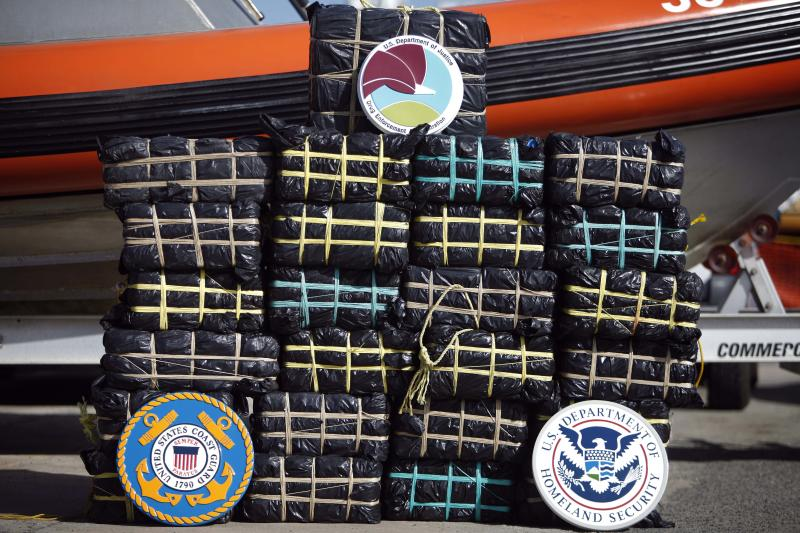 In this Oct. 23, 2013 photo, bales of cocaine that were seized from a speedboat off St. Croix, sit at the Coast Guard base in San Juan, Puerto Rico. Angel Melendez, a Puerto Rico-based special agent for Homeland Security Investigations of the U.S. Immigration and Customs Enforcement agency, said cocaine is increasingly trafficked in larger amounts directly north from Venezuela on boats that refuel at sea during the roughly two-day voyage. (AP Photo/Ricardo Arduengo)