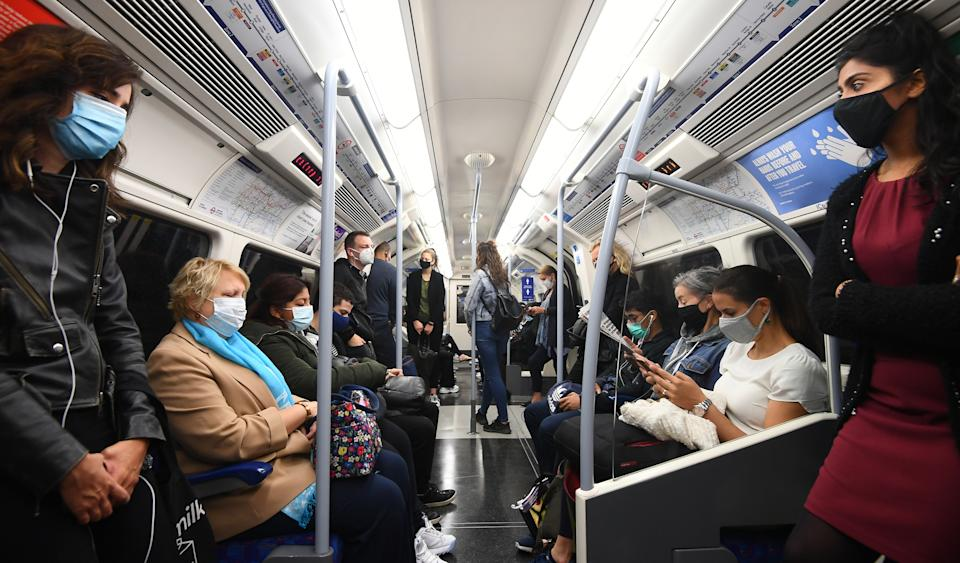 """Passengers ride in an Underground train during the rush hour in London. The Prime Minister said people were returning in """"huge numbers to the office"""" but Downing Street said it could not yet provide information to back up the claim. (Photo by Victoria Jones/PA Images via Getty Images)"""