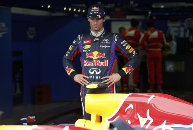Red Bull Formula One driver Mark Webber of Australia looks on after the qualifying session for the Korean F1 Grand Prix at the Korea International Circuit in Yeongam, October 5, 2013. REUTERS/Kim Hong-Ji (SOUTH KOREA - Tags: SPORT MOTORSPORT F1)
