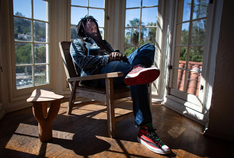 """Tremaine Emory, a creative director and designer, at his Los Angeles home. Emory's streetwear clothing brand tells the story of the Black experience in America. <span class=""""copyright"""">(Jason Armond / Los Angeles Times)</span>"""