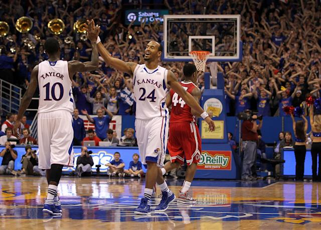 LAWRENCE, KS - DECEMBER 10: Travis Releford #24 of the Kansas Jayhawks celebrates with Tyshawn Taylor #10 in the final seconds of the game against the Ohio State Buckeyes on December 10, 2011 at Allen Fieldhouse in Lawrence, Kansas. The Jayhawks defeated the Buckeyes with a final score of 78-67. (Photo by Jamie Squire/Getty Images)