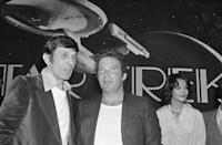 """FILE - In this March 28, 1978 file photo, William Shatner, center, who plays Capt. James Kirk, and Leonard Nimoy, left, who plays Spock, attend a Paramount Studio press conference about the new """"Star Trek"""" movie in Los Angeles. Shatner's latest memoir, """"Leonard: My Fifty-Year Friendship with a Remarkable Man,"""" is out Tuesday, Feb. 16, 2016. In the book, Shatner details his conflicted relationship with friend and """"Star Trek"""" comrade Nimoy, who died last February.(AP Photo/JLR, File)"""