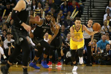 Mar 24, 2019; Oakland, CA, USA; Golden State Warriors guard Stephen Curry (30) dribbles the ball up the court against the Detroit Pistons in the fourth quarter at Oracle Arena. Mandatory Credit: Cary Edmondson-USA TODAY Sports