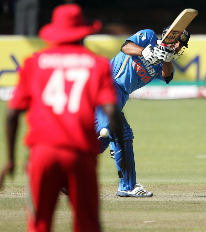 Indian batsman Suresh Raina looks on after hitting a ball during the 4th match of the 5 match cricket ODI series between Zimbabwe and India at the Queens Sports Club in Harare, on August 1, 2013. AFP PHOTO / Jekesai Njikizana.        (Photo credit should read JEKESAI NJIKIZANA/AFP/Getty Images)