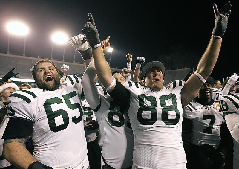Ohio's Skyler Allen (65) and Jordan Thompson (88) celebrate after defeating Utah State in the Famous Idaho Potato Bowl NCAA college football game on Saturday, Dec. 17, 2011, in Boise, Idaho.  (AP Photo/Matt Cilley)