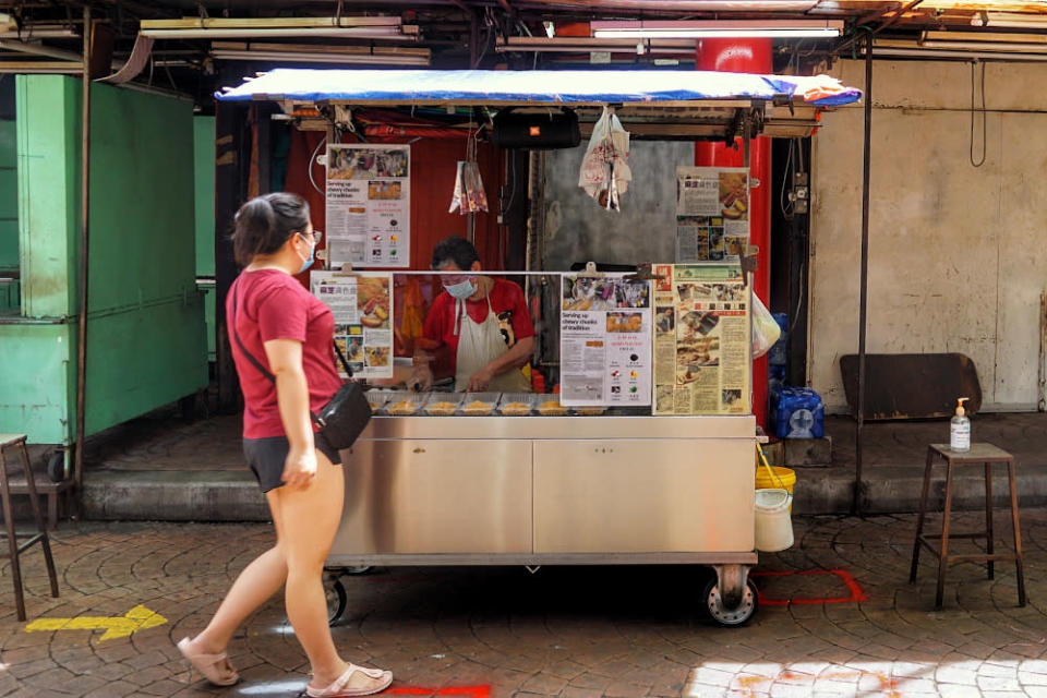 A street food vendor is pictured at her stall on Petaling Street during the conditional movement control order October 18, 2020. — Picture by Ahmad Zamzahuri