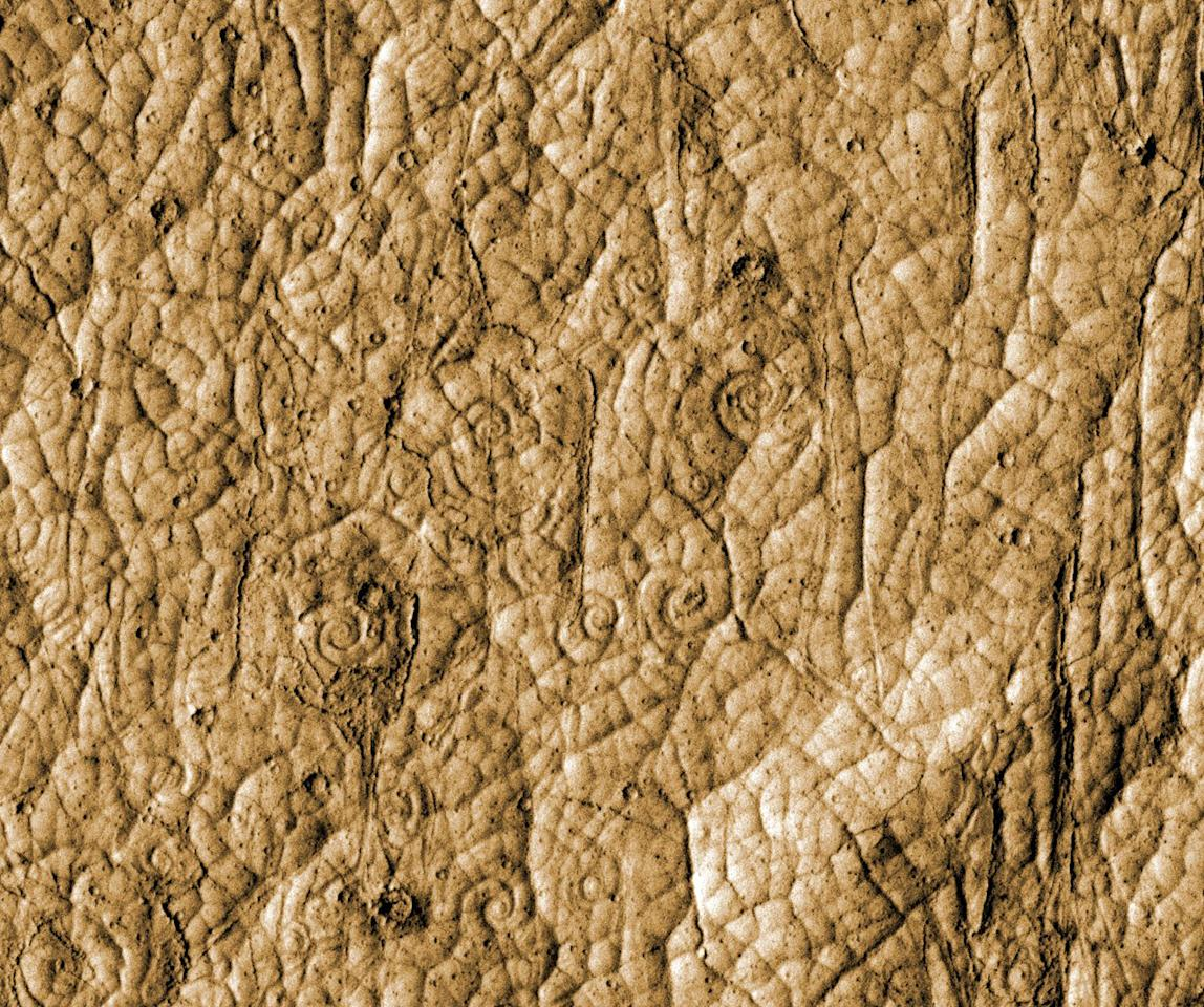 This image provided by NASA on Thursday, April 26, 2012 shows lava flows in the shape of coils located near the equatorial region of Mars. Analyzing high-resolution images of the region, researchers have determined the area was sculpted by volcanic activity in the recent geologic past. This is the first time such geologic features have been discovered outside of Earth. (AP Photo/NASA)