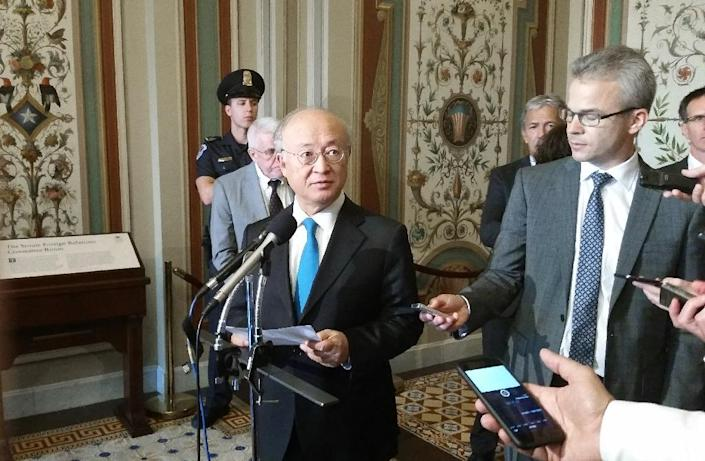 International Atomic Energy Agency director general Yukiya Amano addresses reporters on August 5, 2015 on Capitol Hill after briefing Senate Foreign Relations Committee members about inspection regimes related to the Iran nuclear accord (AFP Photo/Michael Mathes)