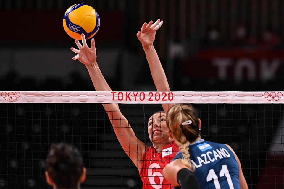 <p>Russia's Irina Koroleva attempts to block a shot in the women's preliminary round pool B volleyball match between Russia and Argentina during the Tokyo 2020 Olympic Games at Ariake Arena in Tokyo on July 27, 2021. (Photo by ANGELA WEISS / AFP)</p>