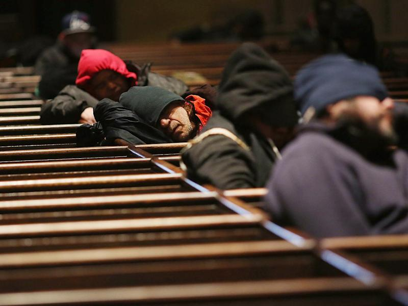 Homeless men try to stay warm in a Manhattan church on an unseasonably cold day in New York City (Getty Images)