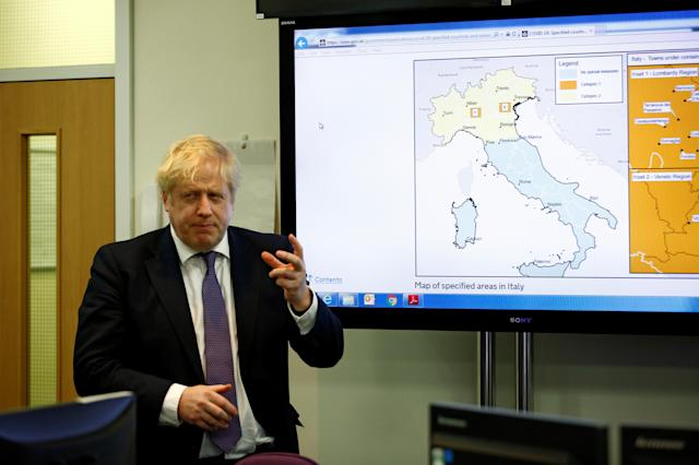 Boris Johnson visits the command centre at the Public Health England National Infection Service in Colindale, north London. (PA Images)