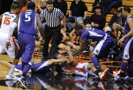 Washington's Abdul Gaddy (0) wrestles for the ball against Oregon State's Roberto Nelson (55) during the first half of an NCAA college basketball game in Corvallis, Ore., Wednesday Jan. 23, 2013. (AP Photo/Greg Wahl-Stephens)