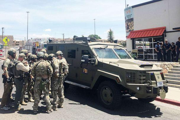 PHOTO: Armed Policemen gather next to an FBI armoured vehicle next to the Cielo Vista Mall as an active shooter situation goes on inside the Mall in El Paso, Texas, Aug., 03, 2019. (Joel Angel Juarez/AFP/Getty Images)