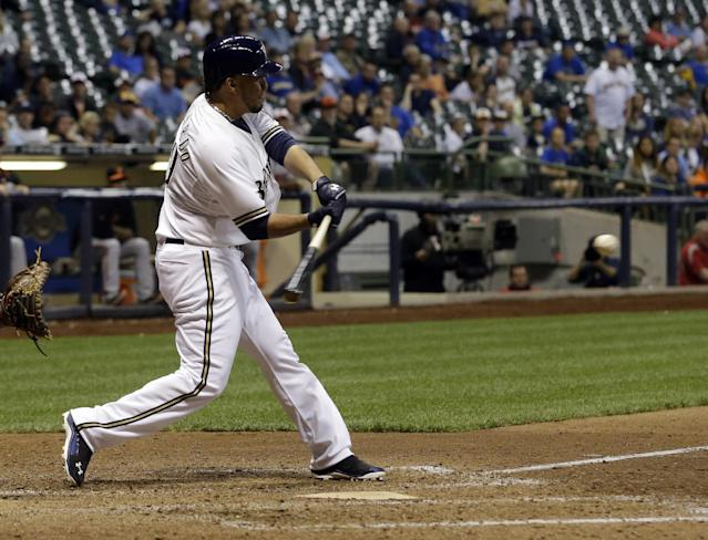 Milwaukee Brewers' Yovani Gallardo hits a game-winning double during the 10th inning of a baseball game against the Baltimore Orioles Tuesday, May 27, 2014, in Milwaukee. The Brewers won 7-6. (AP Photo/Morry Gash)