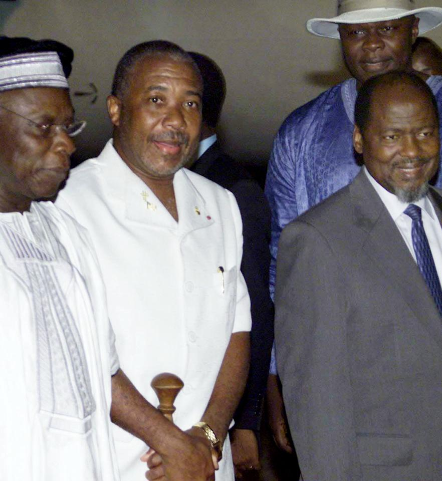 FILE - This Monday, Aug. 11, 2003 file photo shows former Liberian president Charles Taylor, center, flanked by Nigerian President Olusegun Obasanjo, left, and President Joachim Chissano of Mozambique, right, as Taylor arrived into exile at Abuja international airport, Nigeria. On Thursday April 26, 2012, judges at an international war crimes court will pass judgment on warlord-turned-Liberian president Charles Taylor, who is accused of sponsoring rebels responsible for untold atrocities during Sierra Leone's brutal civil war in return for so-called blood diamonds. The historic verdicts at the Special Court for Sierra Leone will mark the first time an international tribunal has reached judgment in the trial of a former head of state since judges in Nuremberg convicted Karl Doenitz, a naval officer who briefly led Germany after Adolf Hitler's suicide. (AP Photo/George Osodi, File)