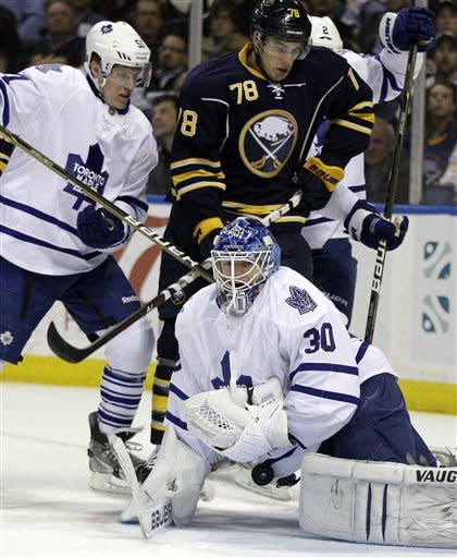 Toronto Maple Leafs goalie Ben Scrivens makes a save under pressure from Buffalo Sabres' Corey Tropp (78) as Maple Leafs' Jake Gardiner (51) defends during the first period of an NHL hockey game in Buffalo, N.Y., Tuesday, April 3, 2012. (AP Photo/David Duprey)