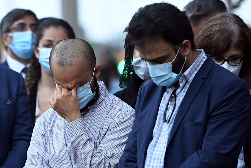 """<span class=""""caption"""">Mourners react during a moment of silence at a vigil for the victims of the deadly vehicle attack on a Muslim family in London, Ont. </span> <span class=""""attribution""""><span class=""""source"""">(THE CANADIAN PRESS/Nathan Denette)</span></span>"""