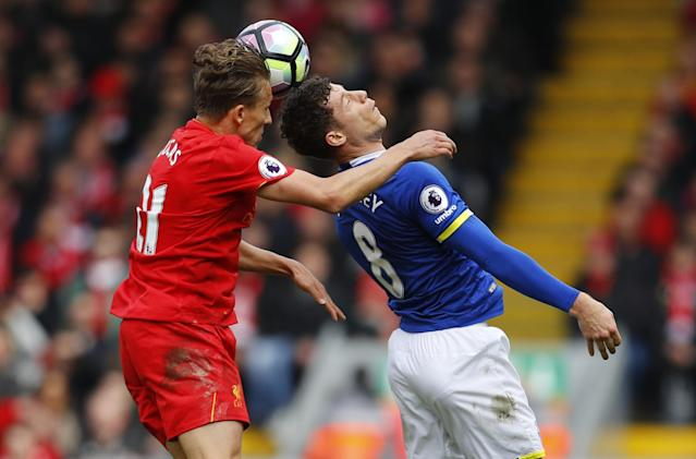 <p>Liverpool's Lucas Leiva in action with Everton's Ross Barkley </p>