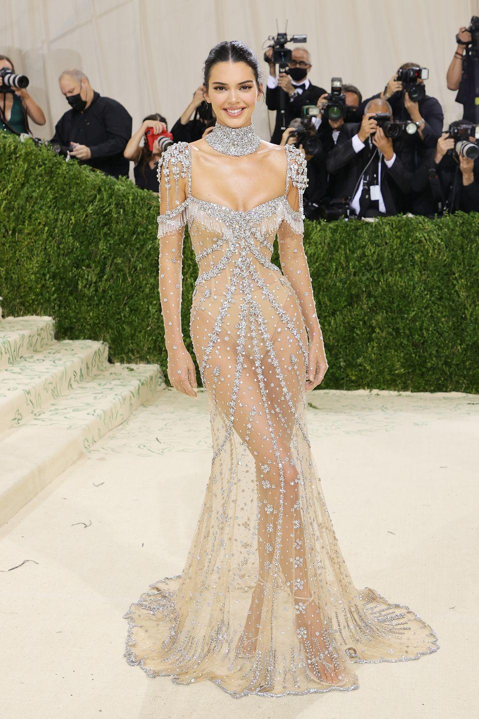 <p>Supermodel Kendall Jenner is no stranger to the Met Gala, and she is also no stranger to a sheer dress, but last night's custom Givenchy ensemble may have been her best effort to date. The gown – which was embellished with crystals and featured a fishtail train and a jewelled neckpiece – was inspired by the house's most famous muse, Audrey Hepburn, and a dress she wore in My Fair Lady.</p>