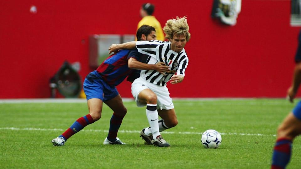 Pavel Nedved of Juventus holds off Gerard Lopez of Barcelona   Rick Stewart/Getty Images