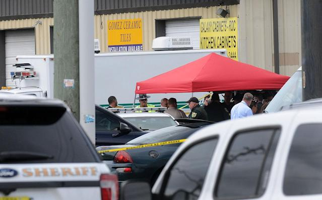 <p>Investigators work the scene of a multiple shooting at an area business in an industrial area on June 5, 2017 northeast of downtown Orlando, Florida. According to published reports, five people were killed in the attack by a man police described as a disgruntled former worker at Fiamma, Inc., which makes accessories for campers and other recreational vehicles. The attacker killed himself, according to police. (Gerardo Mora/Getty Images) </p>