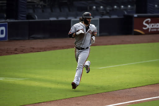 San Francisco Giants' Brandon Crawford scores on a double hit by Mike Yastrzemski against the San Diego Padres in the second inning of a baseball game Sunday, Sept. 13, 2020, in San Diego. (AP Photo/Derrick Tuskan)