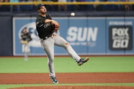 Apr 1, 2019; St. Petersburg, FL, USA; Colorado Rockies third baseman Nolan Arenado (28) throws the ball to first base for an out during the fourth inning against the Tampa Bay Rays at Tropicana Field. Mandatory Credit: Kim Klement-USA TODAY Sports
