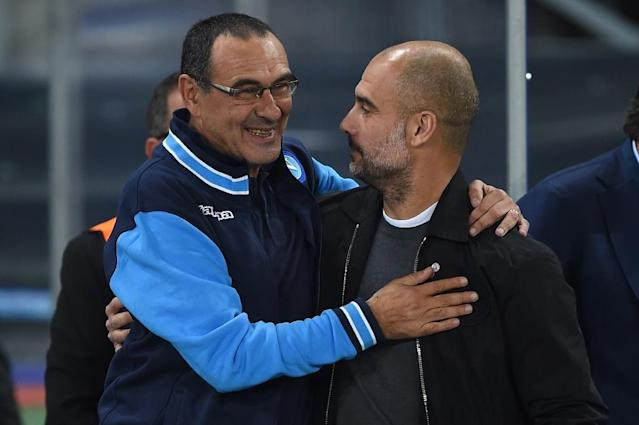 Friendly rivals: Maurizio Sarri is experiencing the same struggles Pep Guardiola did in his first season at Manchester City (AFP Photo/Filippo MONTEFORTE)