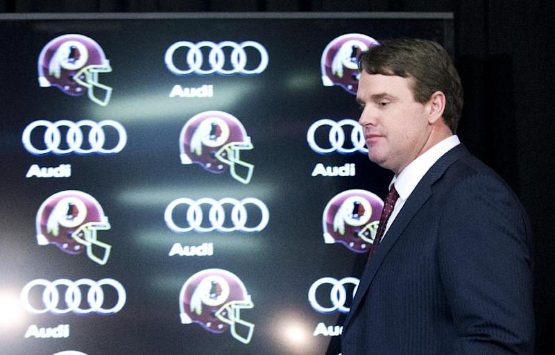 New Washington Redskins head coach Jay Gruden, arrives for a news conference at the Redskins Park in Ashburn, Va., Thursday, Jan. 9, 2014. Jay Gruden was introduced Thursday as the new Washington Redskins head coach, replacing Mike Shanahan and becoming the team's eighth head coach since Daniel Snyder purchased the franchise in 1999. (AP Photo/Manuel Balce Ceneta)