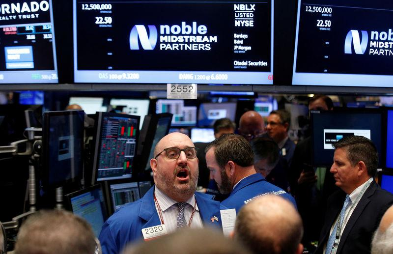 FILE PHOTO: Floor governor Giacchi gives a price for Noble Midstream Partners LP, during the company's IPO on the floor of the NYSE