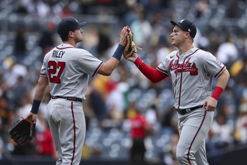 Atlanta Braves' Austin Riley (27) celebrates with Joc Pederson after they defeated the San Diego Padres in a baseball game Sunday, Sept. 26, 2021, in San Diego. (AP Photo/Derrick Tuskan)