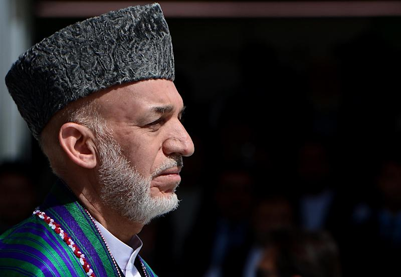 Afghan President Hamid Karzai pictured during an event to mark Independence Day at the Ministry of Defence compound in Kabul on August 19, 2014 (AFP Photo/Wakil Kohsar)