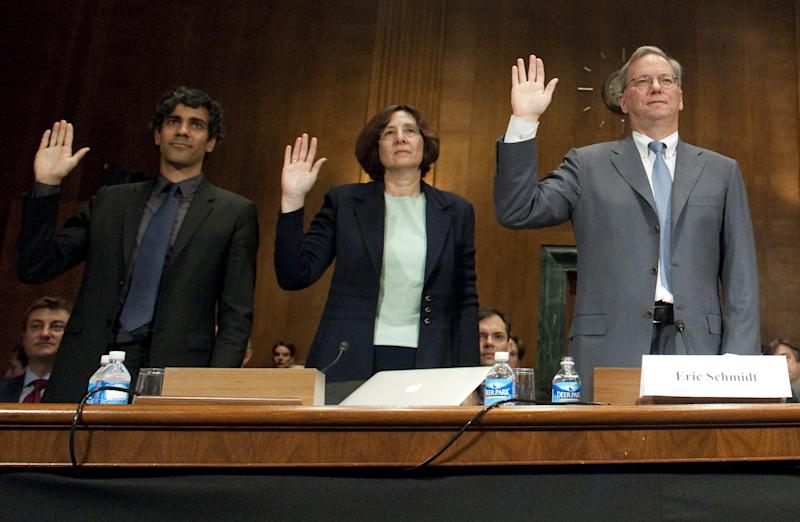 "Eric Schmidt (R), Chairman of Google, Susan Creighton (C), a partner with Wilson Sonsini Goodrich and Rosati, and Jeremy Stoppelman (L), co-founder and CEO of Yelp, are sworn in prior to testifying before the US Senate Judiciary Committee's Subcommittee on Antitrust, Competition Policy and Consumer Rights, during a hearing on Google's business and privacy practices on Capitol Hill in Washington, DC, September 21, 2011. Schmidt defended the Internet giant on Wednesday against accusations it is abusing its dominant position in online search. In written testimony submitted to a US Senate antitrust subcommittee hearing, Schmidt said most complaints about Google ""come from websites that don't like where their sites rank on Google's search results page."" AFP PHOTO / Saul LOEB (Photo credit should read SAUL LOEB/AFP via Getty Images)"