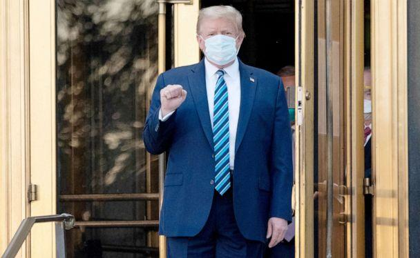 PHOTO: President Donald Trump walks out of Walter Reed Medical Center in Bethesda, Md. after being treated for Covid-19, Oct. 5, 2020. (Saul Loeb/AFP via Getty Images)