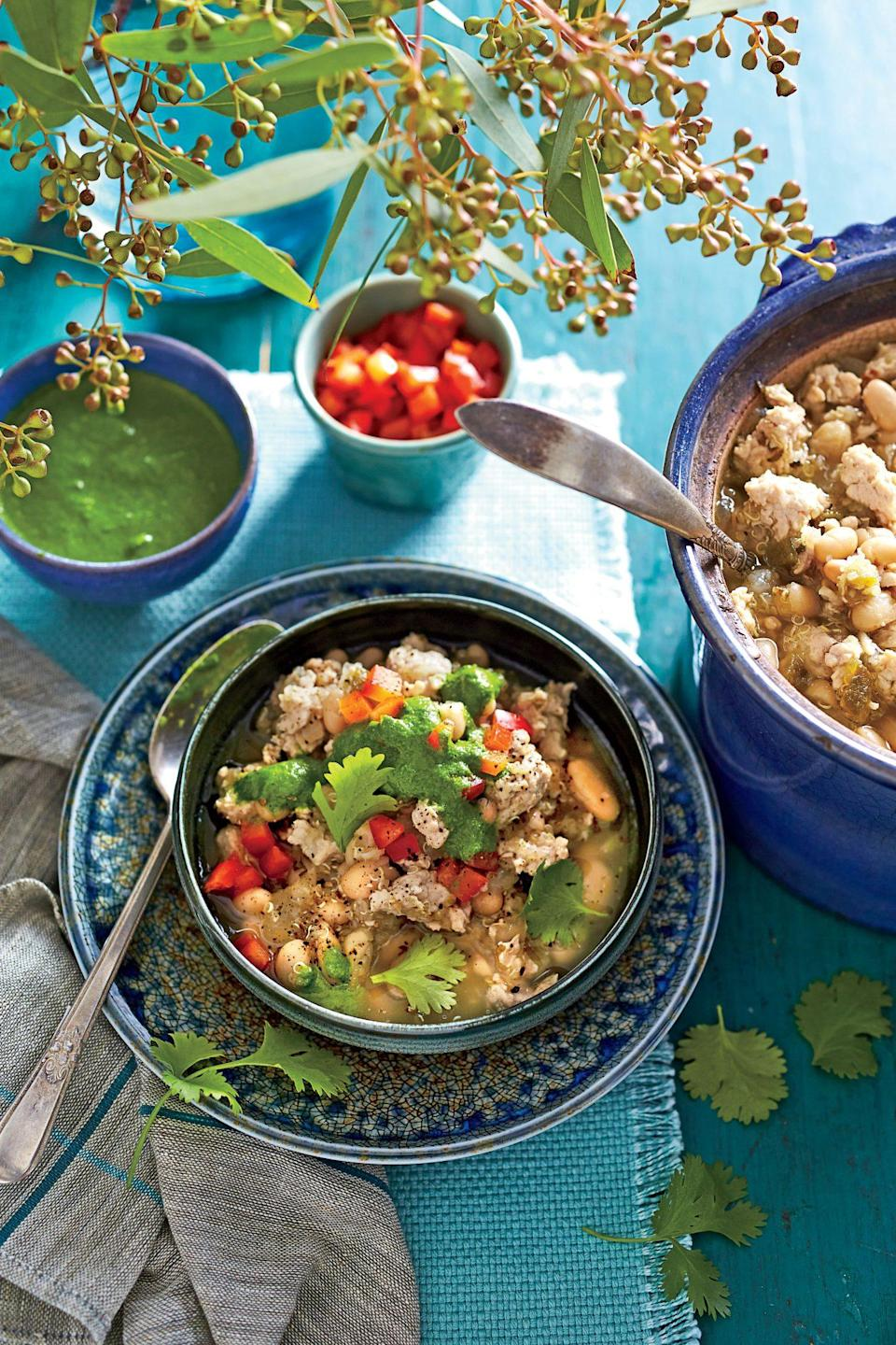 """<p><strong>Recipe: </strong><a href=""""https://www.southernliving.com/syndication/slow-cooker-turkey-chili-1"""" rel=""""nofollow noopener"""" target=""""_blank"""" data-ylk=""""slk:Slow-Cooker Turkey Chili with Quinoa"""" class=""""link rapid-noclick-resp""""><strong>Slow-Cooker Turkey Chili with Quinoa</strong></a></p> <p>This seasonal recipe proves chili doesn't have to be super unhealthy. We love any meal that comes together with the help of our slow cooker, and this lightened-up recipe uses ground turkey instead of ground beef.</p>"""