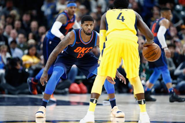Paul George matches up against the Pacers' Victor Oladipo late in Oklahoma City's win Wednesday night. (Getty)