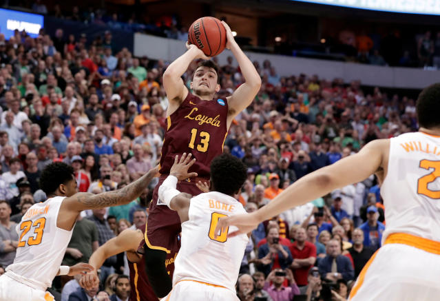 Loyola-Chicago guard Clayton Custer (13) shoots over Tennessee's Jordan Bowden (23) and Jordan Bone (0) and scores in the final seconds of a 63-62 win in a second-round game at the NCAA men's college basketball tournament in Dallas. (AP Photo/Tony Gutierrez)
